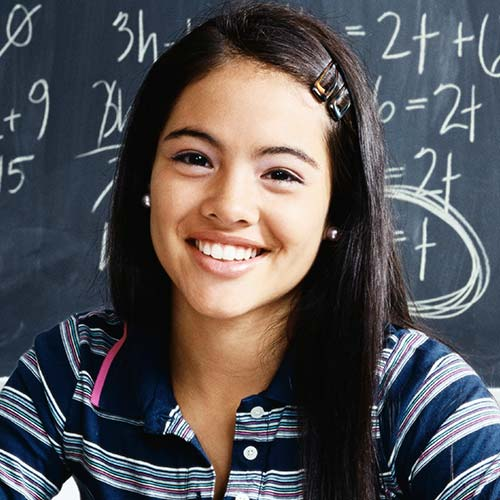 young girl smiling with invisalign